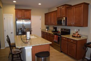 Upgraded Kitchen View, Stainless Steel Appliances, Granite Counter-tops, Kitchen Island, staggered Cabinetry.
