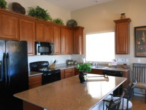 "Gourmet Kitchen, 42"" cabinets, engineered stone countertops, kitchen island, crown moldings, pull outs"
