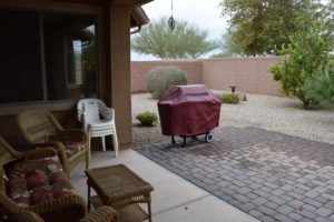 Covered back extended Patio, Easy Care desert landscape, fruit trees