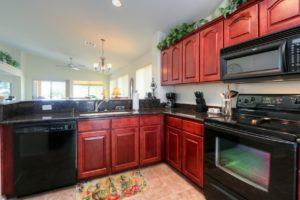 Kitchen, Dark Cherry Cabinets, Black Appliances, Recessed Lighting