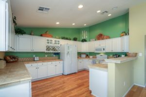 Kitchen, White Cabinets, Recessed Lighting, Tiled Counter-tops