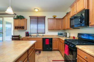 Kitchen, Black Appliances, Tile Flooring