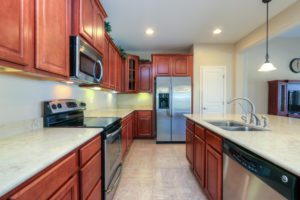 Kitchen, Stainless Steel Appliances, Pendant Lights, Dark Wood, Staggered Cabinets