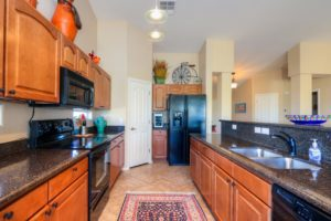 Upgraded Cabinetry, Granite Counter tops, pendant lights, black appliances