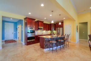 Kitchen, Staggered Cabinetry, pendant lights, Stone veneer breakfast bar