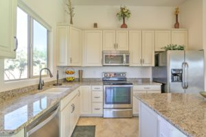 upgraded kitchen, granite counter-tops, white cabinets, stainless steel appliances