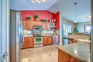 kitchen, granite, wine rack, tile, stainless steel appliances, pendant lights